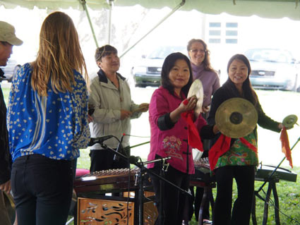 Members of the Melody of China ensemble conduct a Chinese music workshop at Lotus in the Park; photo by Kevin Atkins.