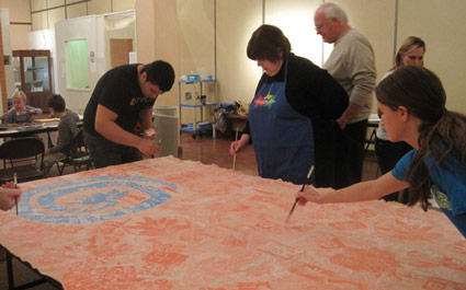 Painting banners at the Mathers Museum