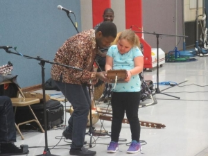 kinobe showing kalimba to a student, Photo by Andrew Collins