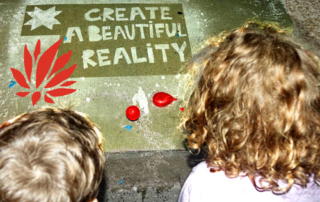 """Create a Beautiful Reality"" Rainworks sidewalk art at the 2016 Lotus World Music & Arts Festival. Photo by Michael Redman."