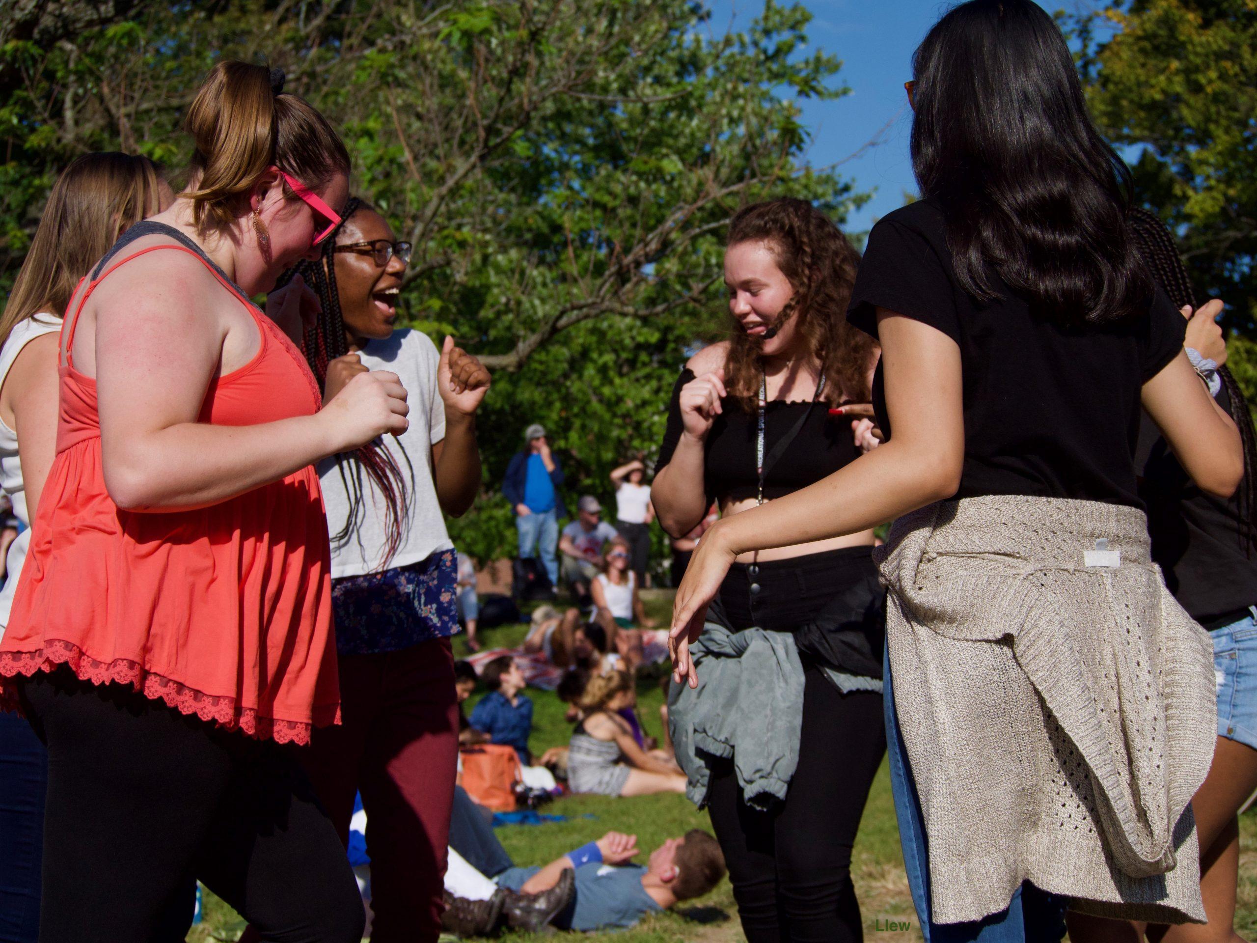 Women Dancing at Lotus in the Park
