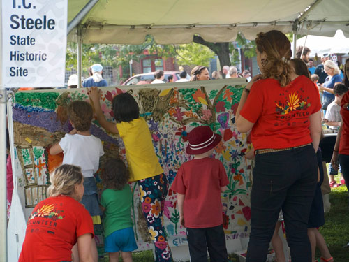 Making art at Lotus in the Park; photo by Merrill Hatlen